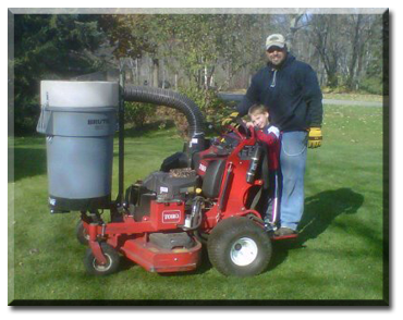 Andy Wachholz, founder and owner of Ground Force Lawncare, Chisago City, MN with his son.